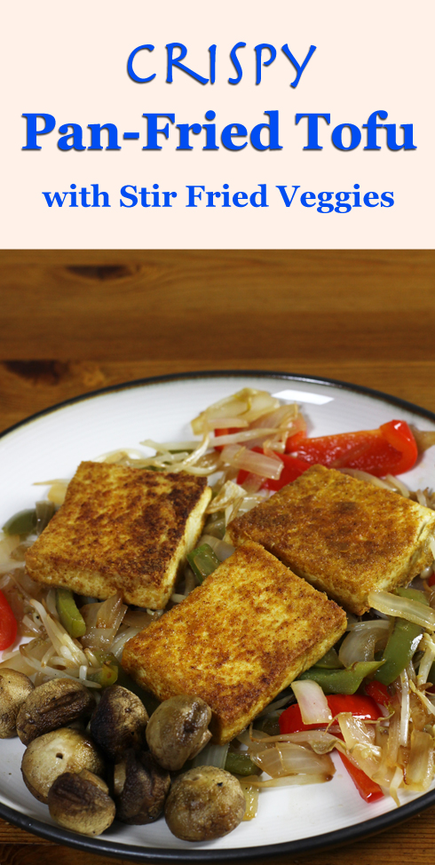A low-carb vegan meal of crispy, pan-fried tofu with stir fried veggies and grilled mushrooms