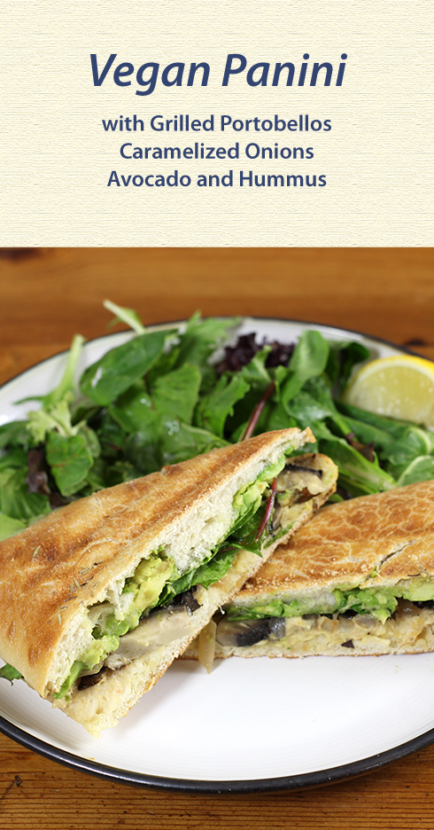 Grilled portobello mushrooms combine with caramelized onion, hummus, avocado and mixed greens to make a satisfying #vegan panini
